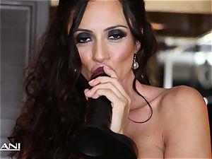 Ariella Ferrara stuffs a large black faux-cock in her puss