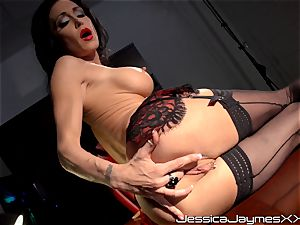insane dark haired Jessica Jaymes thumbs her delicious cunny pie in her office