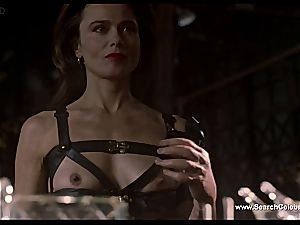 black-haired Lena Olin in underwear demonstrates off her small melons