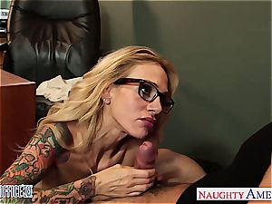 inked platinum-blonde Sarah Jessie tear up in the office