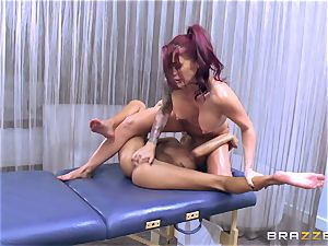 Janice Griffith give Monique Alexander a rubdown to reminisce