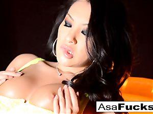 Asa Akira flashes Off Her impressive assets