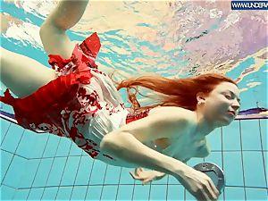 steamy polish redhead swimming in the pool